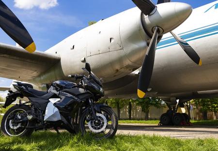 Ukraine, Kiev April -27 2018:Sport bike on the background of an old airplane.Kiev April-27 2018 Editorial