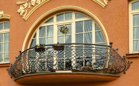 balcony with wrought iron railings