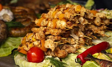 grilled meat on coals on skewers. Banco de Imagens