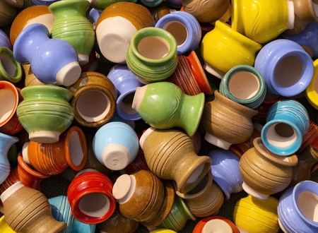 These are small earthenware jugs of different colors.