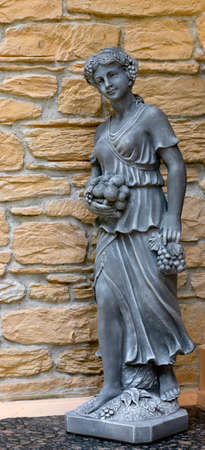 Sculpture of a girl on a wall background.