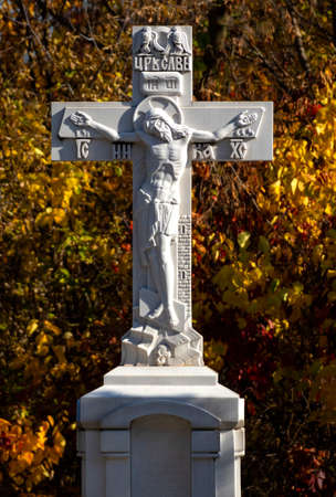 crosses with a crucifix on the grave.