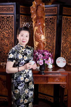 tea house: Attractive woman inside a traditional tea house