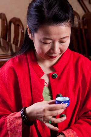 tea house: Attractive woman inside a traditional tea house, reading her tea leaves