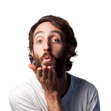 Bearded guy blows a kiss