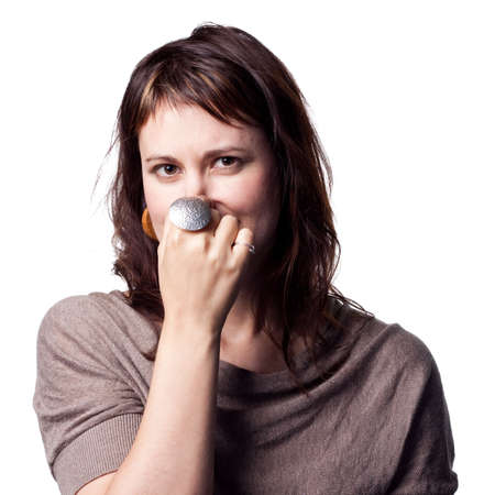 bad smell: A bad smell makes this lady cover her nose