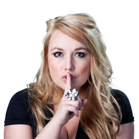 Woman telling people to be quiet. Stockfoto