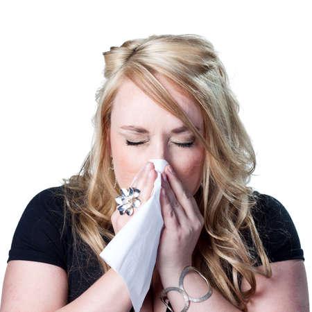 Woman sneezing photo