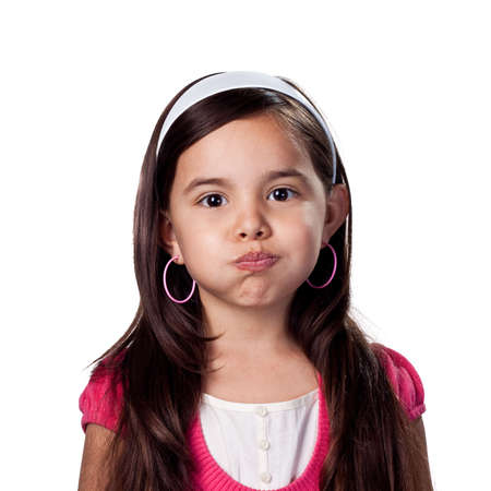 children acting: Child blowing her cheeks out Stock Photo