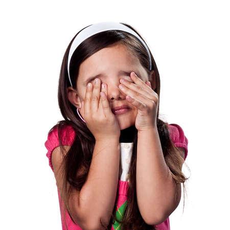 Girl covering her eyes