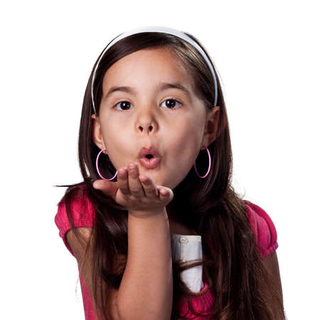 children acting: Pretty young girl blowing a kiss