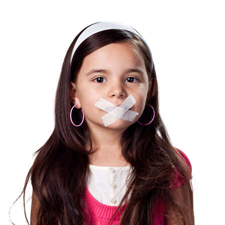 voiceless: little girl with no voice, tape covering her mouth Stock Photo