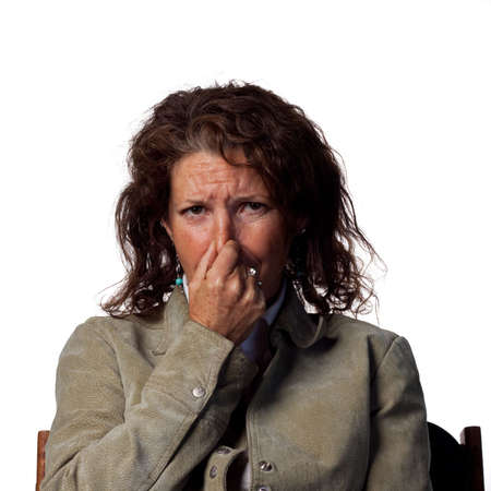 bad smell: Bad smell makes this woman cover her nose