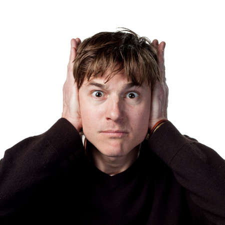 Man covers ears after loud noises Stock Photo