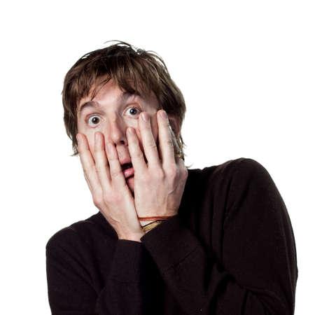 Scared man hiding behnid his hands
