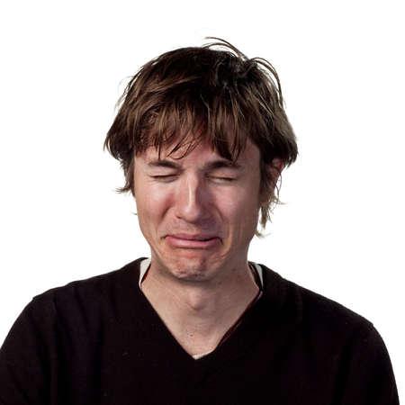 Sad man shedding tears