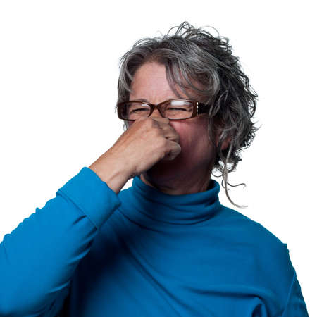 Woman reacts to a very bad smell Stock fotó