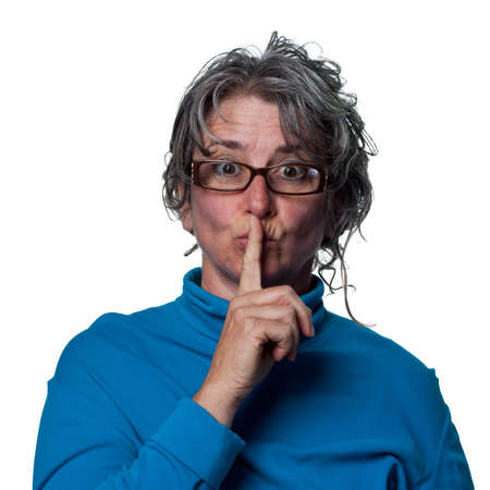 Woman telling people to be quiet, finger on lips photo