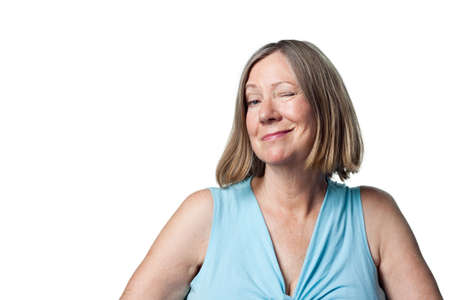 oap: Woman winks at the camera in a playful flirtatious, knowing way Stock Photo