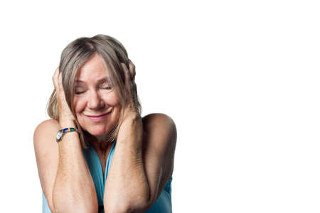loud noise: Woman covers her ears after a loud noise Stock Photo
