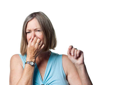oap: Woman covers her nose due to a bad smell Stock Photo