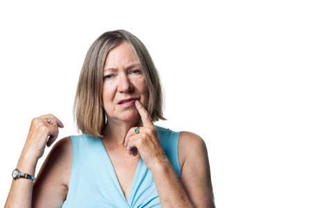 Older woman totally confused, looking bemused Stok Fotoğraf