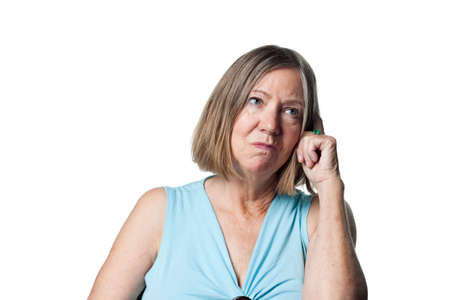 older woman: Older woman totally confused, looking bemused Stock Photo