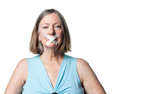 silenced: Senior citizen without a voice, silenced, with tape Stock Photo