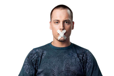silenced: Young man with tape across his mouth, silenced