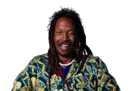 Rastafarian man winking at the camera, isolated on white Stock Photo - 6908839