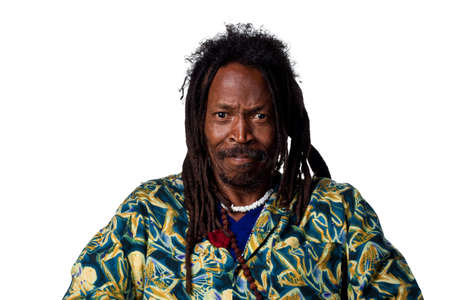 Rastafarian man grimacing at the camera, isolated on white photo