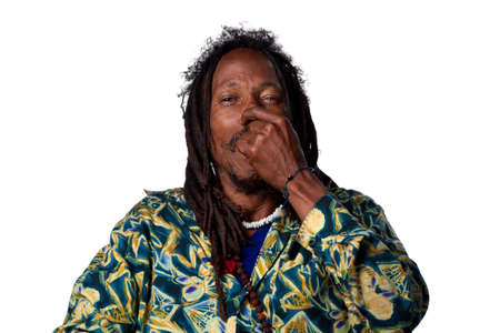 Rasta man pinches his nose due to a bad smell photo