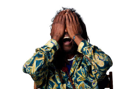 disbelief: Man covers his face in disbelief, isolated image