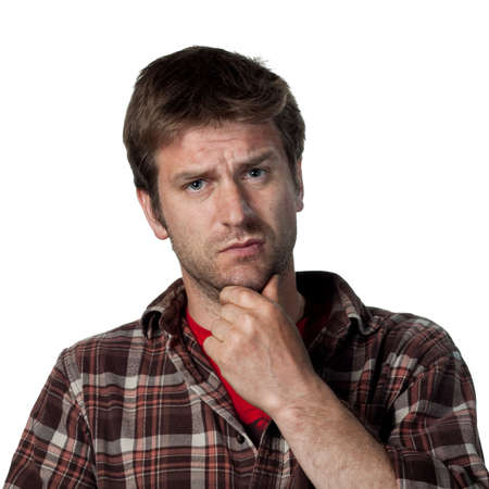 persona confundida: Hombre joven confundida con una mirada cuestionamiento