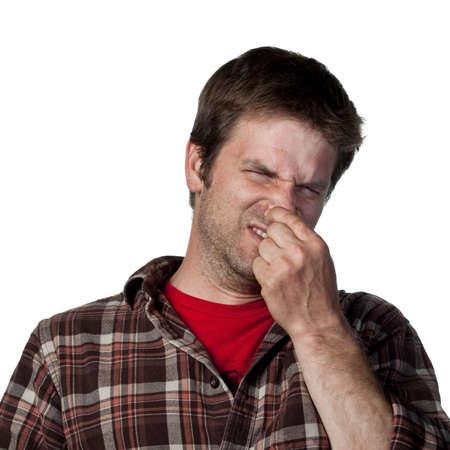 Uomo copre il suo naso a causa di un cattivo odore Archivio Fotografico - 6875456