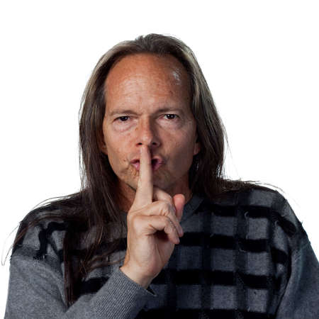 Portrait of a native american man telling people to be quiet photo