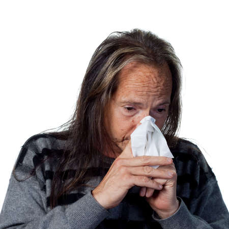 Native American man with allergys and a tissue photo