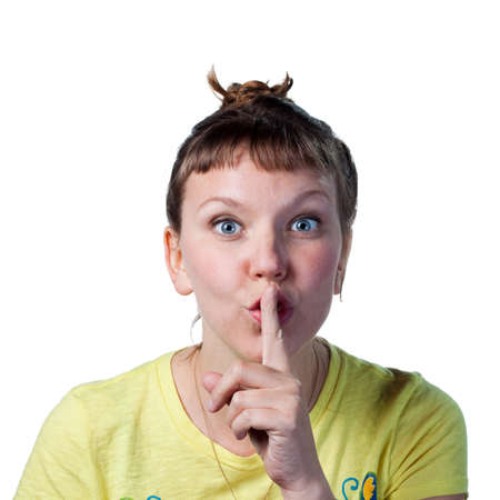 Woman tells people to be quiet, fingers on lips