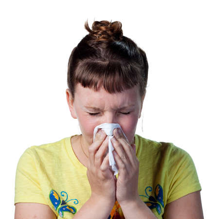 Woman blowing her nose, struggling with allergies photo