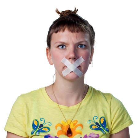 voiceless: Young woman with tape across her mouth, voiceless