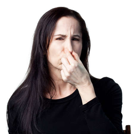 Woman covers her nose, bad smells in the air Stock Photo - 9939036