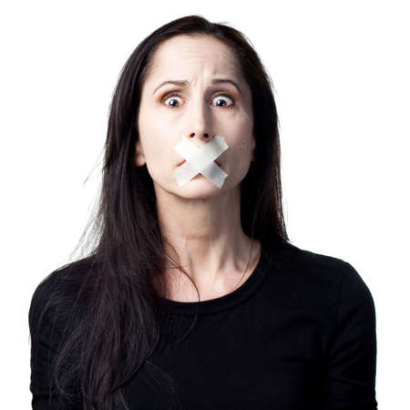 silenced: Woman without a voice, silenced, tape over mouth Stock Photo