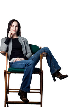 Attractive actress in her chair, isolated image photo