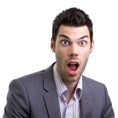 Aantrekkelijke jonge man met een blik van ongeloof en verbazing Stockfoto