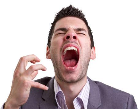estornudo: Hombre joven con un resfriado a punto de estornudar