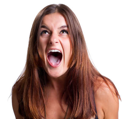 Young woman screams out loud with her mouth open
