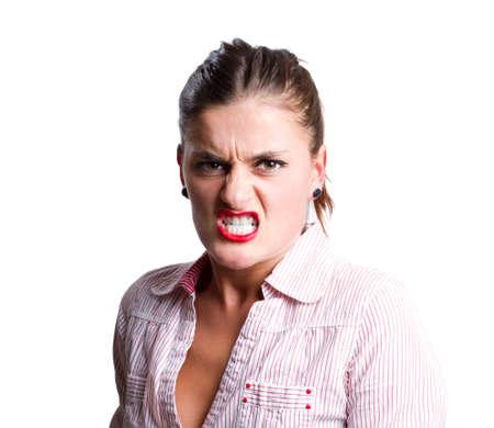 Mujer joven y agresiva parece como si estuviera a punto de convertirse en violenta Foto de archivo - 9938978