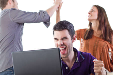 Three happy 20 somethings react to some fantastic news Stock Photo - 10415724