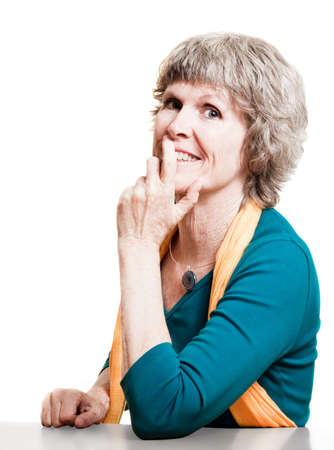 Attractive older woman smiling at the camera Stock Photo - 10470645