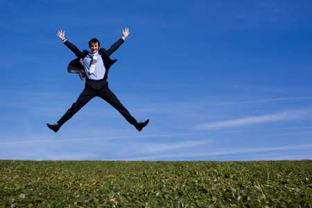 employee satisfaction: Happy jumping businessman